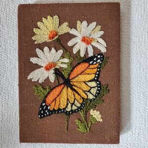 Vintage Monarch and daisy embroidered wall art.